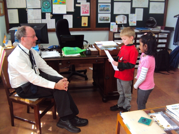 Principal, Adrian Moody being interviewed by elementary school students